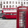 London Red Telephone Booth and Red Bus - Stock Photo