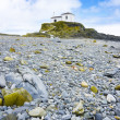 Beautiful church in a rocky beach — Stock Photo