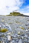 Beautiful church in a rocky beach — Stock Photo