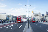 London buses and The City, London — Stock Photo