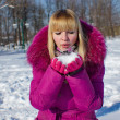 Stock Photo: Girl blowing on snow