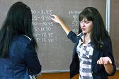 Students near the blackboard — Stock Photo