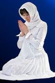 A woman praying — Stock Photo