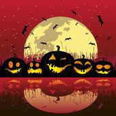 Halloween pumpkins under the moon — Stockvector