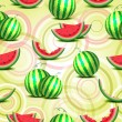 Seamless background of whole watermelons and slices — Stock Vector #43311881