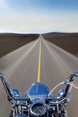 Motorcycle Speeding Down the Road — Stockfoto