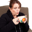 Stock Photo: Blowing on Hot Tea