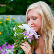Smelling the Flowers — Stock Photo #43921873