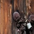 Old door with an old iron lock and padlock. — Stock Photo