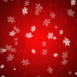 Snowflakes background in red.  — Stock Vector