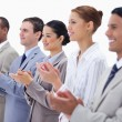 Close-up of a business team smiling and applauding — Stock Photo