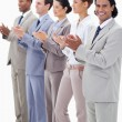 Business team smiling and applauding — Stock Photo #13900529