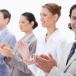 Close-up of a business team smiling and applauding — Stock Photo #13900530