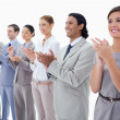 Close-up of colleagues smiling and applauding — Stock Photo