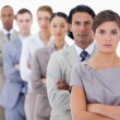 Big close-up of serious workmates in a single line — Stock Photo