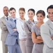 Close-up of a business team smiling in a single line looking tow — Stock Photo #13900651