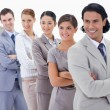 Big close-up of a business team in a single line looking towards — Stock Photo