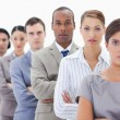 Big close-up of a serious business team in a single line crossin — Stock Photo