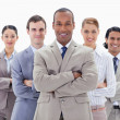 Close-up of a business team smiling and crossing their arms — Stock Photo #13900732