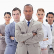 Royalty-Free Stock Photo: Close-up of a serious business team crossing their arms