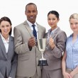 Close-up of a business team holding a cup — Stock Photo #13900847