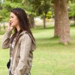 Stock Photo: Side view of teenager phoning