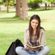 Stock Photo: Teenager sitting with textbook