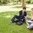 Tutoring in a sunny park - Stock Photo