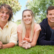 Portrait of three smiling students in a park — Stock Photo #13906638