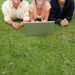 Three smiling students - Stockfoto