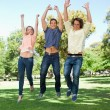 Three students jumping — Stock Photo