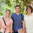 Stock Photo: Portrait of Three students side by side