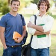 Portrait of two standing handsome students talking — Stock Photo
