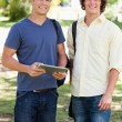 Stock Photo: Portrait of two smiling male students with touch pad