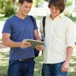Stock Photo: Two smiling male students with touch pad