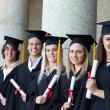 Graduates posing in single line — Stock Photo #13908146