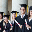 Portrait of graduates posing in single line — Stock Photo #13908156