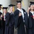 Graduates posing the thumb-up — Stock Photo