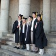 Graduates posing while smiling — Foto Stock