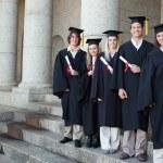 Five happy graduates posing — Stock Photo