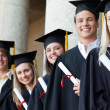 Close-up of five graduates posing — Stock Photo #13908219