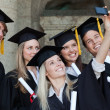 Stock Photo: Close-up of five graduates taking a picture of themselves