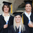 Stock Photo: Close-up of five happy graduates posing