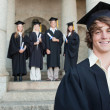 Close-up of a smiling graduate — Stock Photo #13908289