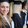 Close-up of a beautiful graduate with blue eyes — Stock Photo