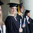 Blonde graduate — Stock Photo #13908311