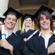 Stock Photo: Low angle-shot of graduate posing