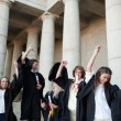 Graduates dancing in togas — Stock Photo #13908324