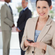 Stok fotoğraf: Young secretary standing in front of colleagues while sending a