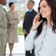 Young executive woman talking on the phone with one hand on her — Stock Photo